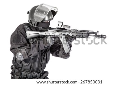 Russian special forces operator in black uniform and bulletproof helmet - stock photo