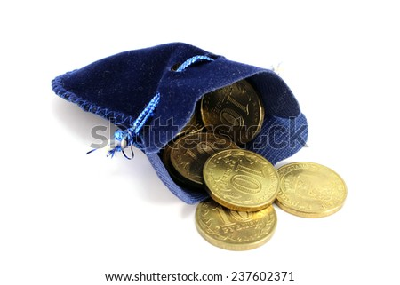 Russian ten-coin spill out of a velvet pouch - stock photo