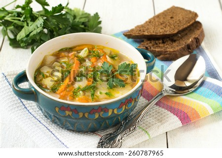 Russian traditional dish - cabbage soup, parsley, black bread on a white background. Selective focus - stock photo