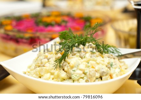 Russian traditional salad olivier. - stock photo