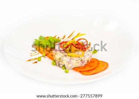 Russian traditional salad olivier with peas - stock photo