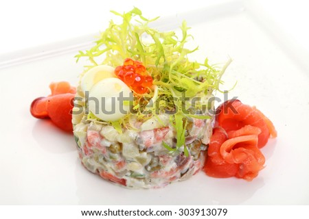 Russian traditional salad with red caviar and salmon