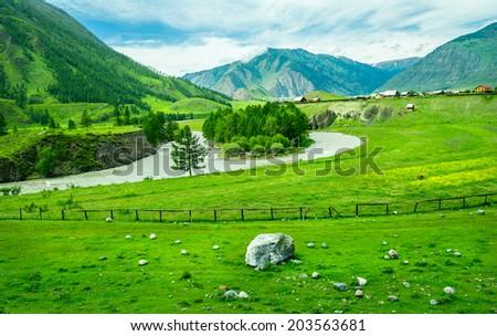 Russian village and rural landscape at Altai, Russia - stock photo
