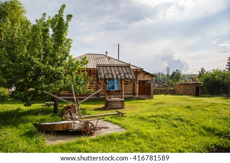 Russian village. old house with utensils and the well in the yard. Vasily Shukshin's house. Srostki Siberia Altay . - stock photo