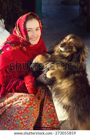 Russian woman in ethnic costume with dog - stock photo