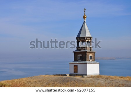 Russian wooden church on river coast - stock photo
