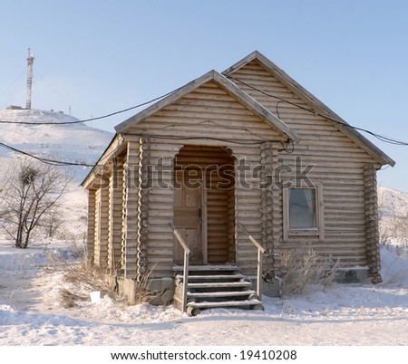 Russian wooden small house in the winter - stock photo