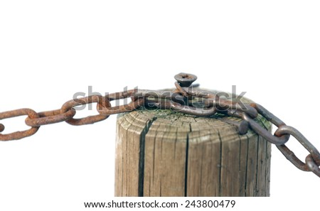 Rust chain with the wooden pole and white background - stock photo