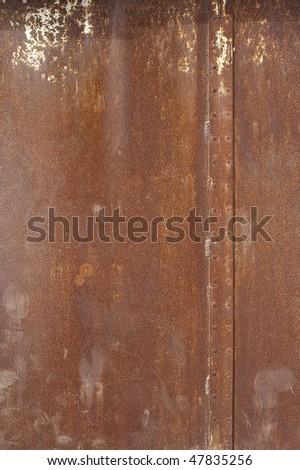Rust covered steel metal panel - stock photo