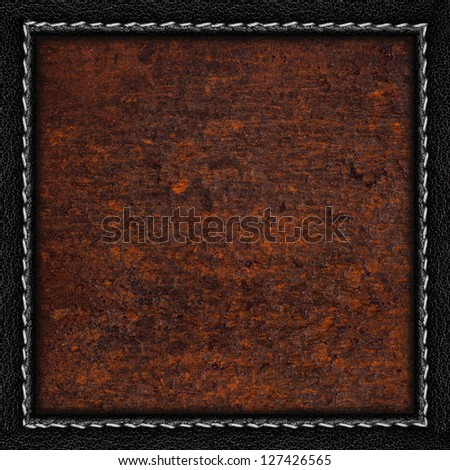 rust metal sheet background or iron brown texture in black leather frame