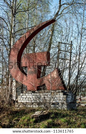 rust monument of hammer and sickle - stock photo