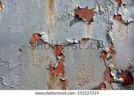 Rust on the surface of metals, with paint residues - stock photo
