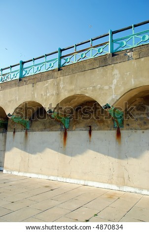 Rust stains and a blue sky at Brighton seafront, West-Sussex in England. - stock photo
