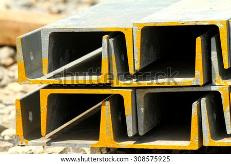 Rust steel angles bunch for raw material Steel Transmission line tower - stock photo