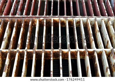 Rust steel grating of drain cover - stock photo