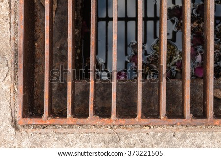 rust  steel grating sewage gate - stock photo