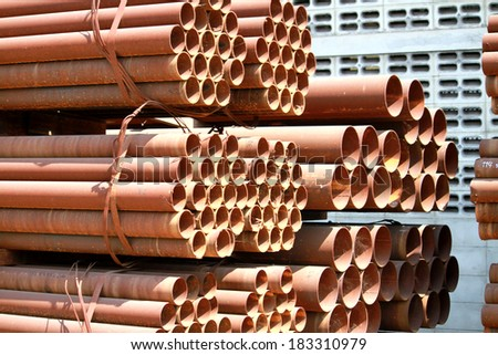 Rust steel pipes bunch in warehouse - stock photo