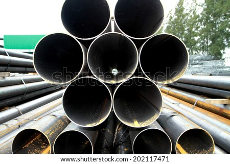 Rust steel pipes bunch in warehouse