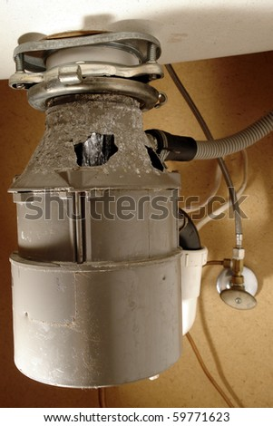 Rust Through Corrosion Damaged Household Under Sink Food Waste Garbage  Disposal Food Grinder Appliance With Water