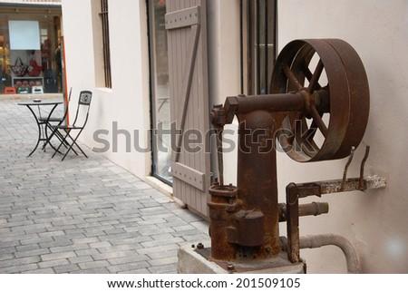 Rust water pump at Tel Aviv's Old Train Station Complex, Israel - stock photo