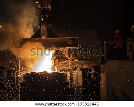 RUSTAVI, GEORGIA - May 1, 2014Hot steel pouring in Rustavi Metallurgical Plant, Georgia - stock photo