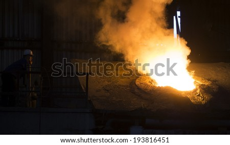 RUSTAVI, GEORGIA - May 1, 2014Hot steel pouring in Rustavi Metallurgical Plant, Georgia - stock photo