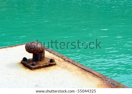 Rusted boat mooring - stock photo