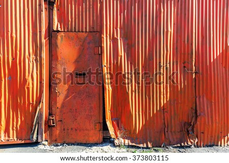 rusted corrugated iron wall in an industrial area - stock photo