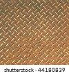 Rusted diamond pattern steel plate - stock photo