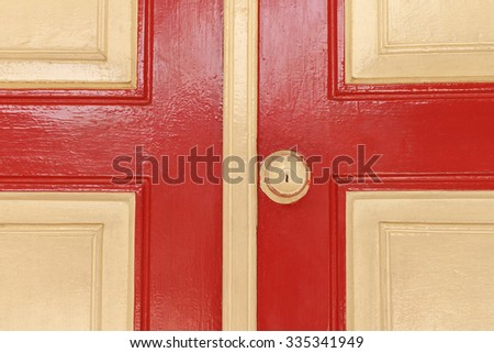 rusted door knob on red wooden door - stock photo