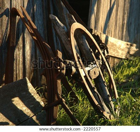 rusted farm equipment - stock photo