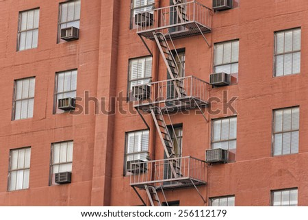Rusted Fire ladder on abandoned building in Los Angeles - stock photo