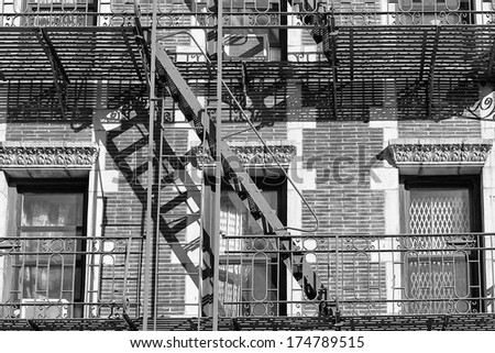 Rusted Fire ladder on abandoned building in New York - stock photo