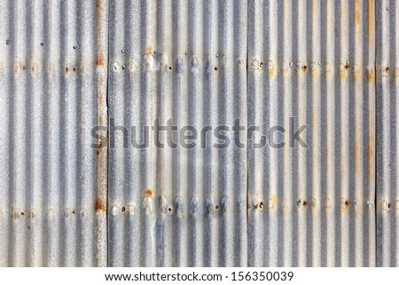 Rusted, galvanized, corrugated iron siding, vintage background. - stock photo