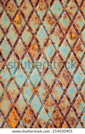 Rusted green steel plate with relief pattern, background photo texture - stock photo
