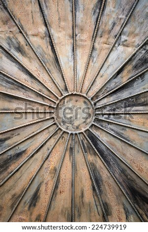 Rusted grungy metal wall background with decor - stock photo