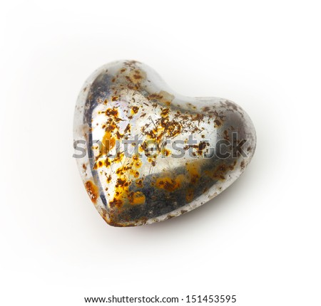 Rusted heart. Rusted and bruised old chrome heart isolated on white. - stock photo