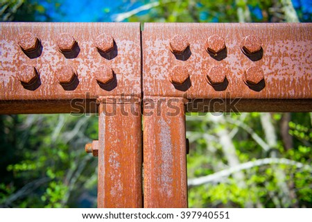 Rusted High Strength Bolt Groups and Beam Connection with Welds - stock photo