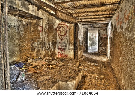 rusted interior of abandoned military bunker - stock photo