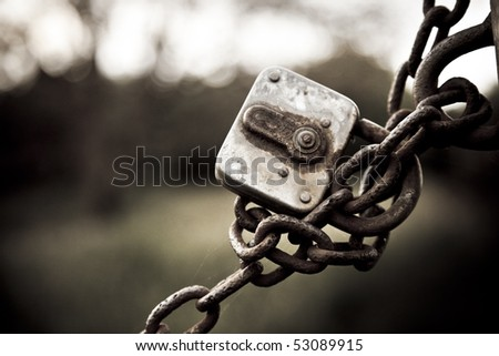 rusted lock with chain - stock photo