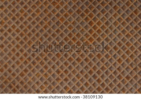 Rusted metal background grid patterned texture - stock photo
