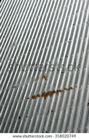 Rusted metal sheeting with ripples for use as background