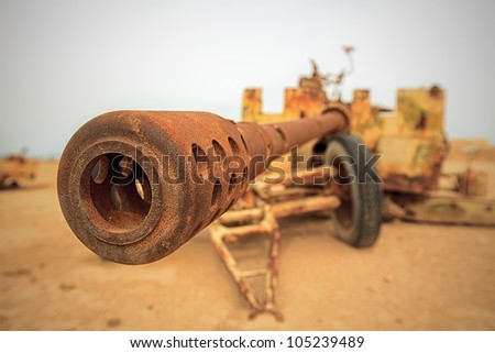 Rusted Military Anti-Tank Cannon Gun During the Desert Storm War - stock photo