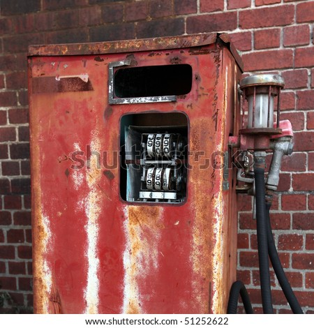 Rusted old gas pump - stock photo