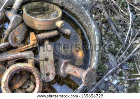 rusted old vintage scrap metal lying abandoned - stock photo