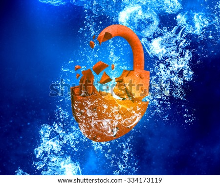 Rusted opened padlock under blue clear water - stock photo