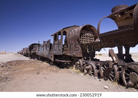 Rusted out, abandoned locomotives at the train graveyard, Uyuni, Bolivia - stock photo