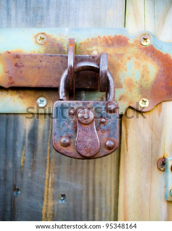 Rusted padlock - stock photo
