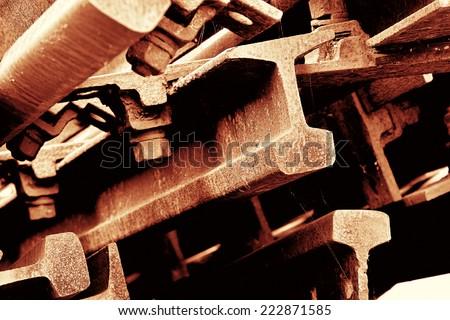 rusted railroad tracks at a scrap yard - stock photo