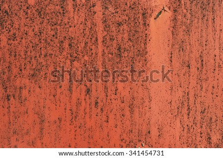 Rusted red painted metal wall. Detailed photo texture - stock photo